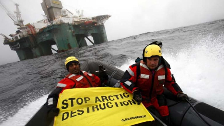 Greenpeace activists prepare to scale an oil rig off the coast of Greenland.