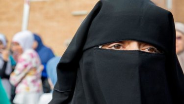 A woman in a niqab.