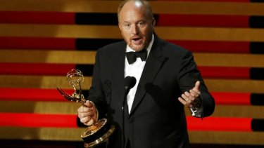 An appreciative Louis C.K. collects the Emmy.