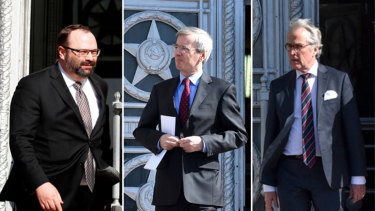 Ambassadors from (L-R) Canada,  Britain and Germany are pictured leaving the Russian Foreign Ministry on Friday after being summoned to hear how many of their staff would be expelled.