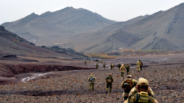 Members of Australia's Special Operations Command move through the Garmab Valley, in Oruzgan Province.