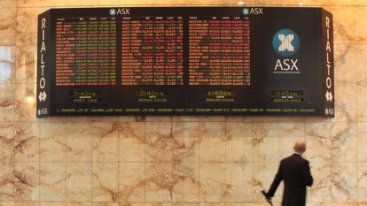 ASX slides, Aussie dollar jumps as unemployment ticks lower