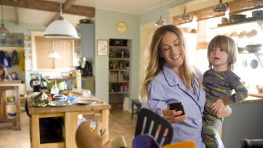 "Sarah Jessica Parker  in the film ""I Don't Know How She Does It"", smiling but stressed."