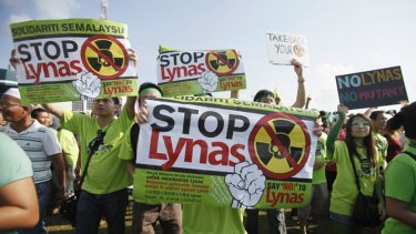 Residents display placards to protest against the construction of the Lynas earth plant in Malaysia's town of Kuantan.