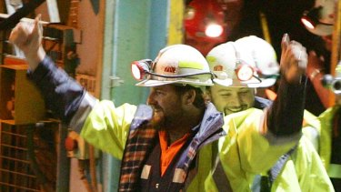 Miners Todd Russell, left, and Brant Webb emerge from the mine.