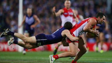 PERTH, AUSTRALIA - SEPTEMBER 21:  Heath Grundy of the Swans gets tackled by Hayden Ballantyne of the Dockers during the AFL Second Preliminary Final match between the Fremantle Dockers and the Sydney Swans at Patersons Stadium on September 21, 2013 in Perth, Australia.  (Photo by Michael Dodge/Getty Images)