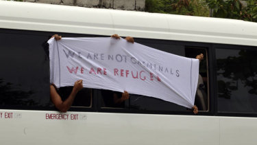 Asylum seekers protest outside the Nauru courthouse.