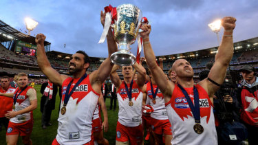Tripping the light: Adam Goodes and Jarrad McVeigh hoist the premiership cup.