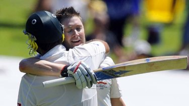 Michael Clarke (right) celebrates scoring a double hundred with his new sponsor's bat in Adelaide.