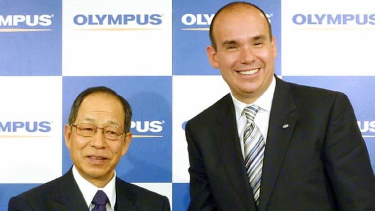Happier days ...Michael Woodford, right, with Tsuyoshi Kikukawa.