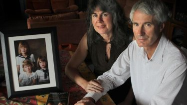 Anthony and Christine Foster with a picture of their daughters, two of whom were abused by Father Kevin O'Donnell.