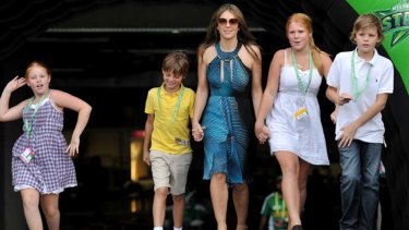 Hurley with her son Damien (in yellow) and Warne's children (L-R) Summer, Brooke and Jackson at the MCG in Melbourne in December 2011.