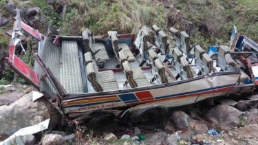 The remains of the  bus that crashed into a gorge in Uttarakhand, northern India, killing at least 40 people.