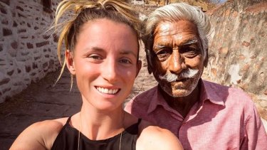 Jolie King snapping a selfie with a man in the city of Jodhpur, India.