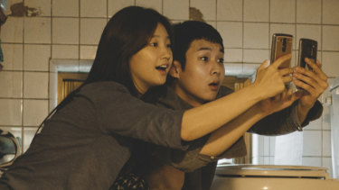 Searching for free Wi-Fi ...  Park So-Dam and Choi Woo-shik in Parasite.