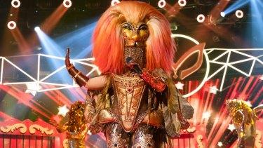 Kate Ceberano performs as The Lion on The Masked Singer Australia.