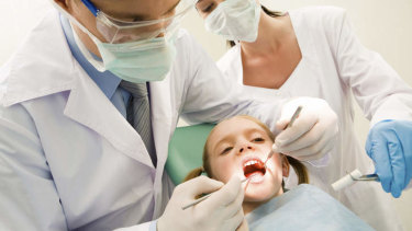 Say uuuuuh! Economists view dentists as the perfect barometer for gauging America's economic recovery.