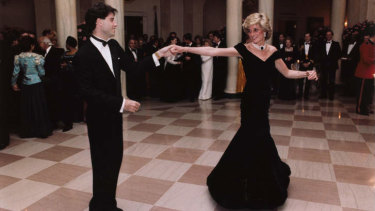 Actor John Travolta dances with the Diana, Princess of Wales at a White House dinner in Washington in 1985.