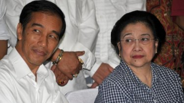 Jokowi with his mentor and matriarch of the PDI-P party, Megawati Sukarnoputri.