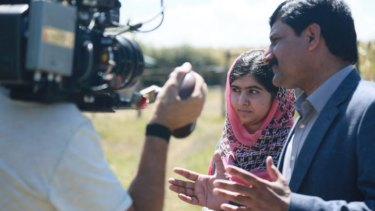 Malala Yousafzai and her father, Ziauddin Yousafzai, in the documentary, <i>He Named Me Malala</i>.