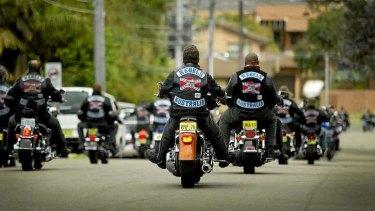 Rebel bikie gang members ride in a group.