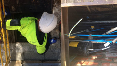 An NBN workers scrambles out of a 'spaghetti junction' in Perth's CBD.