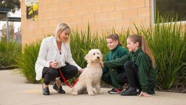 Kangaroo Flat Primary School principal Kim Saddlier and students with the school dog Bonnie.