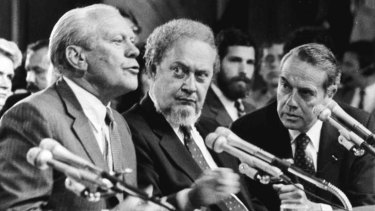 Former US president Gerald Ford, left, introduces Supreme Court nominee Robert Bork, centre, in 1987.
