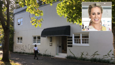 Graffiti was found on the wall of the Paddington office of Roxy Jacenko (inset) on Wednesday morning.