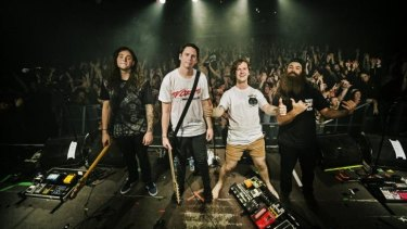 Brisbane band Violent Soho performs to a lively audience enjoying the city's vibrant night life.