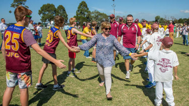 Rosie Batty leads the teams out on Tyabb Oval through a guard of honour at a football match in his honor.