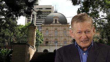 Former Queensland assistant health minister Chris Davis has been awarded $1.4 million.