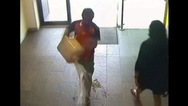 In this image from CCTV footage shown in court, Nur Islam empties petrol onto the floor of the bank.