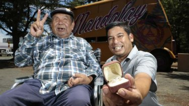 Mandalay Bus owners George Thaung and his son Stewart with a pair of opals given to them by a former homeless man, who had been helped by George before finding the gems at Lightning Ridge.