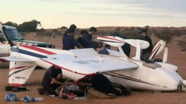 Two West Australians have been dragged from a light aircraft that crashed as it landed at William Creek.