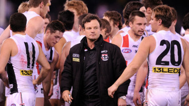 Scott Watters surrounded by St Kilda players during a game.