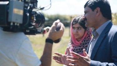 Malala Yousafzai and her father, Ziauddin Yousafzai, in the documentary, <i>He Named Me Malala</i>.