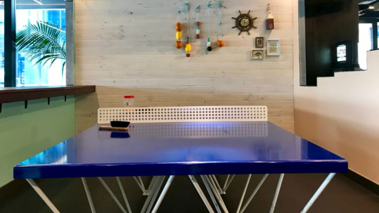 The new tenants have created family-friendly spaces that house ping pong tables and arcade games.