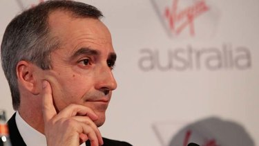 Virgin Australia has booked big writedowns as it clears the decks for John Borghetti's successor.