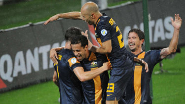 Alex Brosque is mobbed after his goal against Saudi Arabia.