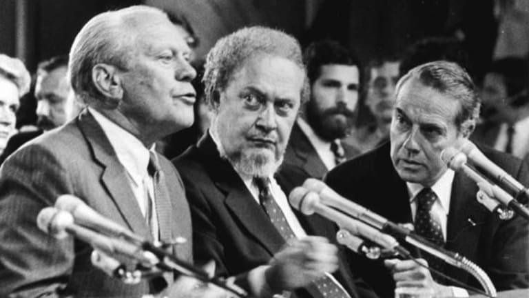Former US president Gerald Ford, left, introduces Supreme Court nominee Robert Bork, centre, in 1987.