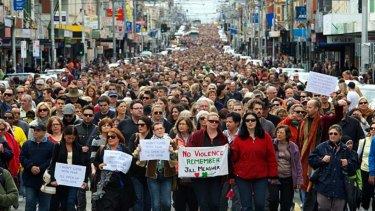 "Tens of thousands of people walk along Sydney Road, Melbourne in a ""Peace March"" after the murder of Jill Meagher in 2012."