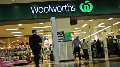 'Essential worker hero' shelf stackers in pay dispute with Woolworths