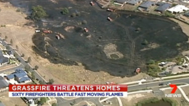 A grassfire damaged fences of 20 homes in Wallan on Saturday and is being treated as suspicious. Picture: Seven News.