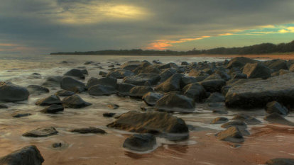 Packages of white powder wash up on Queensland beaches