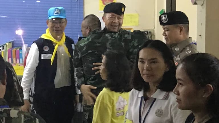 Army chiefs embrace after the successful rescue mission.