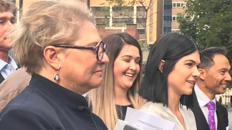 Ayla Cresswell (centre) outside the Brisbane Supreme Court following the verdict.