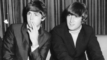 Paul McCartney and John Lennon at a Sydney press conference in June 1964.