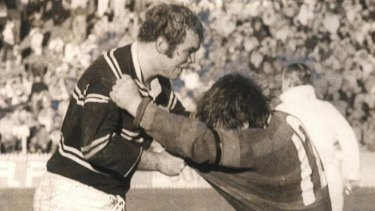 English hardman: Manly's Malcolm Reilly (left) goes toe to toe with George Piggins.
