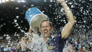 Brian Goorjian gets a soaking as  his Sydney Kings celebrate their third successive NBL championship in 2005.